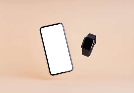 smart phone and smart watch on cream color background Reklamní fotografie