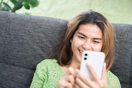 focus on smile woman dental braces using phone mobile, orthodontic treatment