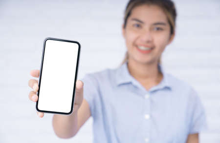 smile women holding phone showing white screen