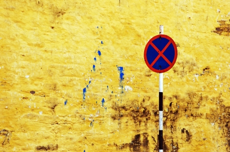 street sign against a textured yellow wall Stock Photo - 18878241