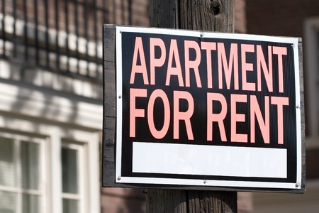 apartment for rent sign in front of an elegant building photo