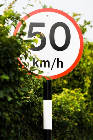 traffic sign indicates 50 km h - slow down at fifty Stock Photo - 18917605