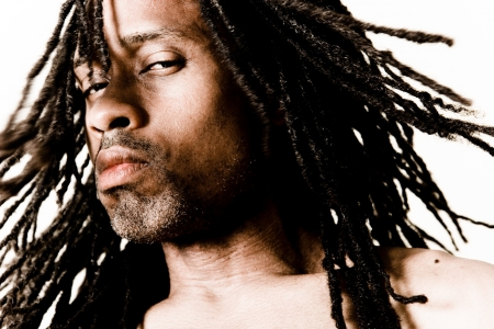 skeptic: portrait of a male skeptic with dreadlocks Stock Photo