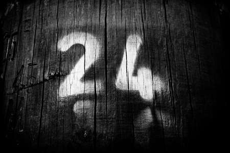 the main number is twenty four on wood Stock Photo - 19108575