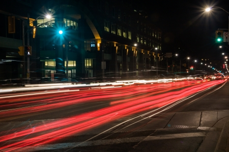 car taillights streaks on city streets at night - long exposure Stock Photo - 20386230