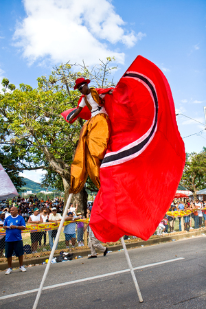 stilt: Trinidad, West Indies - February 2, 2008 - Stilt walker at the  Junior Parade of the Bands  festivities during Trinidad Carnival celebrations on February 2, 2008 in Port Of Spain, Trinidad W I