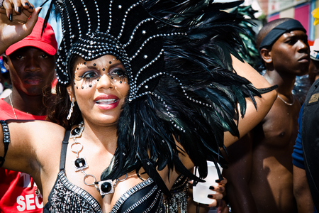 masquerader: Trinidad, West Indies - February 5, 2008 - Female masquerader in black feathered headdress takes part in Carnival Tuesday celebrations on February 5, 2008 in Port Of Spain, Trinidad W I Editorial
