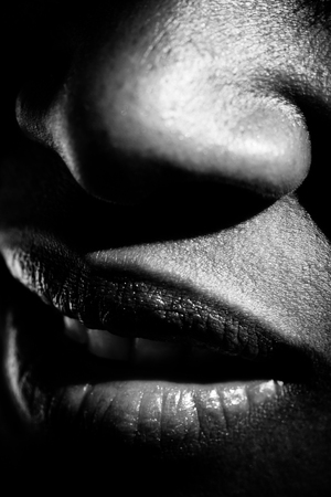extreme closeup of the nose and mouth of a woman Stock Photo