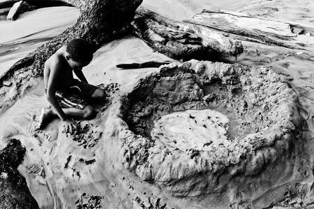 boy playing on a beach in Trinidad