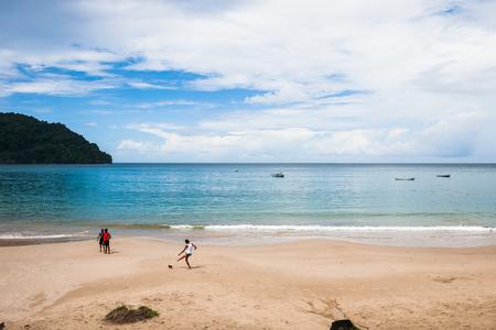 kids playing soccer on a beach Trinidad