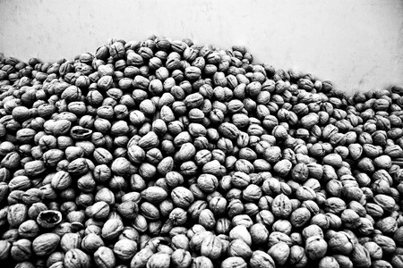 walnuts against a wall at the market Stock Photo