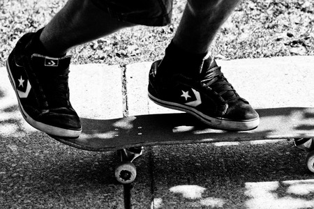 teen wearing converse skate shoes on skateboard ready for action