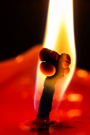 flame and the red candle abstract