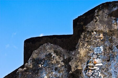 section of a wall in Trinidad showing exposed stone