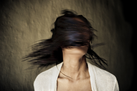 portrait of a mystery woman with hair covering face