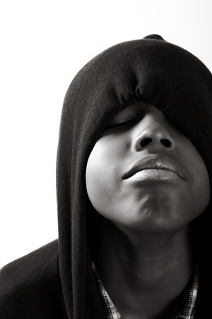 boy in hoodie with face partially covered Stock Photo