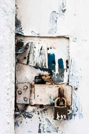 close-up of a padlock on a white door