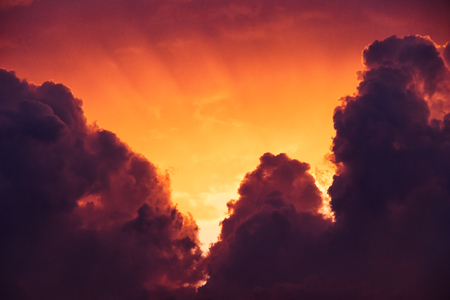 moody, smoky and golden at sundown  - cumulonimbus clouds