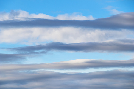 stratocumulus clouds form a pattern in an early evening blue sky