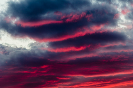 mysterious fiery sky at sunset with altocumulus clouds