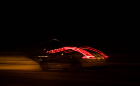 vehicle lights up the night with long exposure light streaks