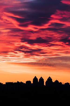 colorful fiery sky at sundown with altocumulus clouds