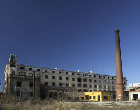 Abandoned factory with brick chimney