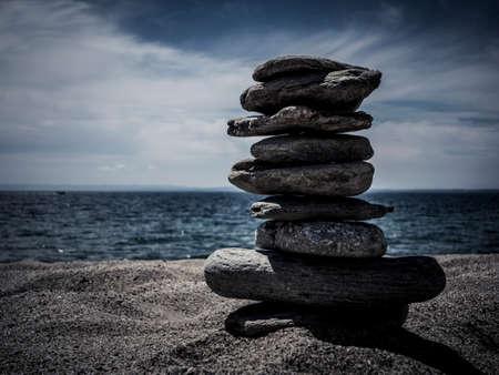 Pebbles stack over sea