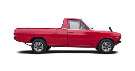 Small Classic Japanese red pick-up car isolated on white