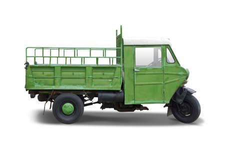 Three wheels old vehicle isolated on white Standard-Bild