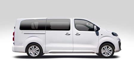 White mini bus side view isolated on white background Standard-Bild