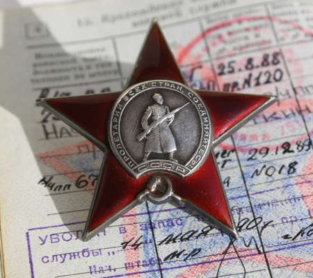 Order The Red Star on the background of military ID Editorial