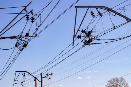 energies: industrial, railway lines of communications and power transmission on sky background