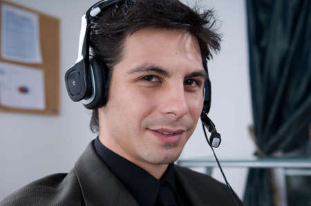 Attractive Male answering a call at work photo
