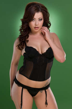 reggicalze: Posa modello sexy in lingerie Archivio Fotografico
