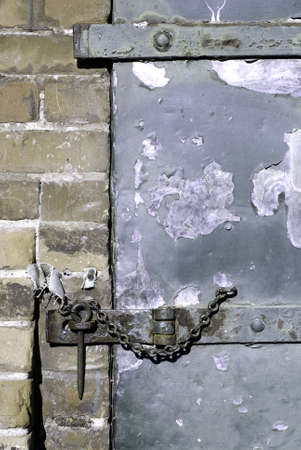 A hasp and staple on an old warehouse door. Stock Photo - 795991