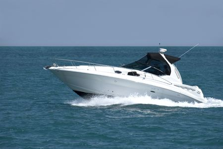 A white speedboat at the height of summer. Stock Photo