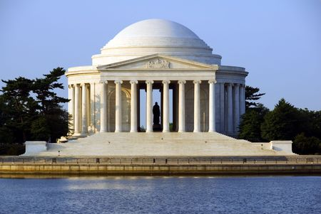 The Thomas Jefferson Memorial photographed across the Tidal Basin shortly after dawn.