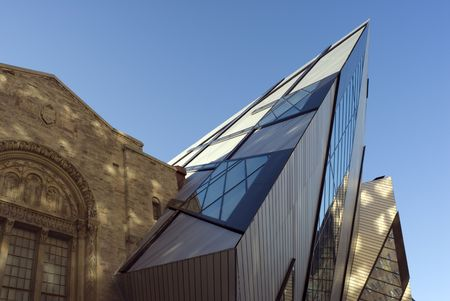 The north face of the Royal Ontario Museum in Toronto, Canada, showing part of the new Michael Lee-Chin Crystal extension designed by Daniel Libeskind, dappled by the earling morning sunlight.