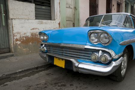 A bright blue 1950s American car still running on the streets of Cuba.