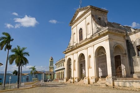 Santisima Trinidad Church in the central square of Trinidad, Cuba. The Romantico Museum is housed in the building immediately to its left.