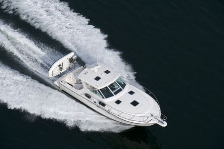 A white speedboat shot from above while travelling fast. Imagens - 4515880