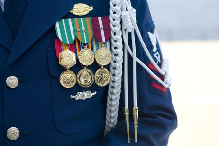 The medals, buttons, and badges of a US Coast Guard Company Commander. Zdjęcie Seryjne - 5466406