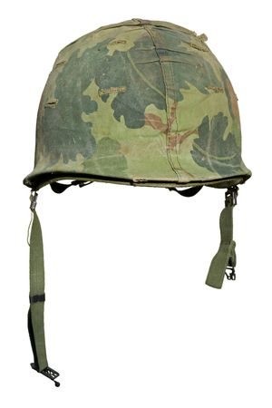A US military helmet with an M1 Mitchell pattern camouflage cover from the Vietnam war. Фото со стока