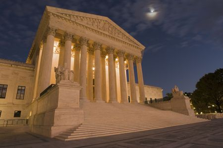 A night shot of the front of the US Supreme Court in Washington, DC.  Stock Photo