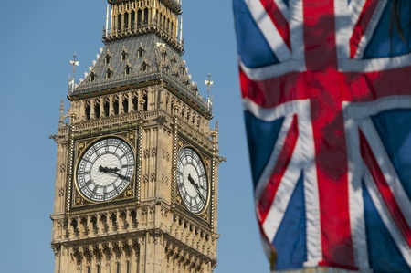 The Union Flag flying in front of the clock tower, commonly referred to as Big Ben, of the Palace of Westminster.