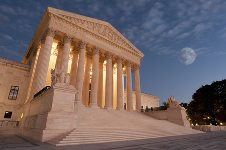 A night shot of the front of the US Supreme Court in Washington, DC.