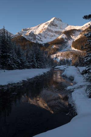 rockies: The sunrises on a majestic peak in the rockies Stock Photo