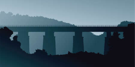 Silhouette of an old railway bridge crossing a valley