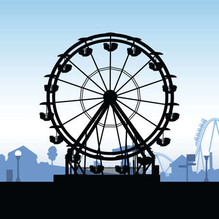 Silhouette of a ferris wheel at a carnival.